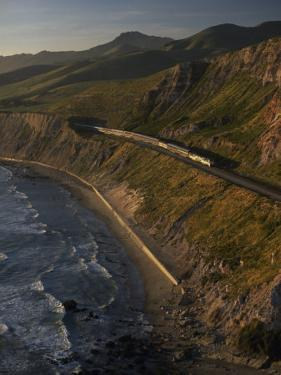 The Coast Starlight Train Snakes Past the Santa Ynez Mountains, California by Phil Schermeister
