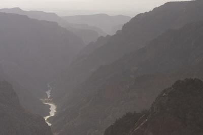 The Gunnison River Winds Through a Canyon from the South Rim of Black Canyon by Phil Schermeister