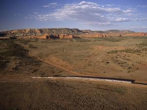 The Southwest Chief Train Heads West from Albuquerque, New Mexico by Phil Schermeister