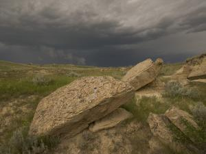 Thunderclouds Gather Above Eroded Buttes in the Grasslands by Phil Schermeister
