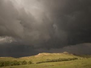 Thunderclouds Gather Above Little Missouri Grasslands and Buttes by Phil Schermeister