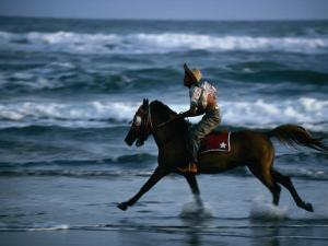 Boy Riding Pony on Beach Parangtritis, Central Java, Indonesia by Phil Weymouth
