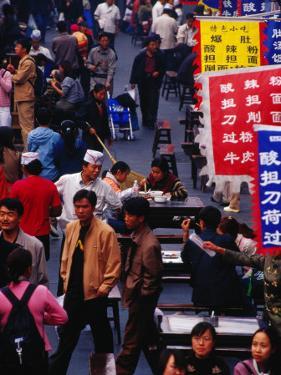 Crowds on Wangfujing Street in Dongcheng Bejing, China by Phil Weymouth