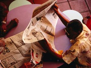 Men Reading Newspaper at Tekka Central Market, Little India, Singapore, Singapore by Phil Weymouth