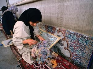 Women Weaving Carpets in Factory, Esfahan, Iran by Phil Weymouth