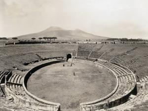 Amphitheater of Pompeii with Vesuvius in Background by Philip Gendreau