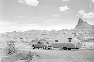 Automobile & Trailer on Badlands Highway by Philip Gendreau