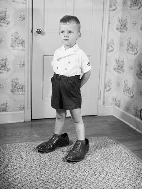 Boy Wearing Men's Shoes by Philip Gendreau
