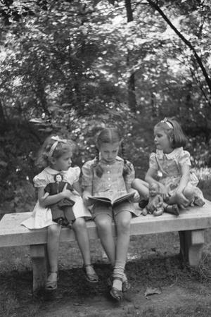 Girls Reading on Park Bench by Philip Gendreau