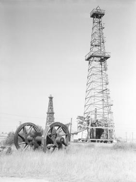 Oil Derricks in Field by Philip Gendreau