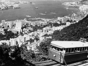 Peak Train with Hong Kong in Foreground by Philip Gendreau