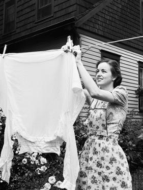 Woman Hanging Laundry Out to Dry by Philip Gendreau