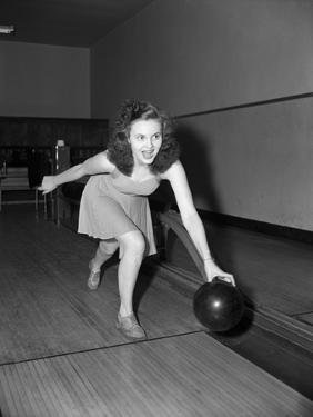Young Woman Bowling by Philip Gendreau