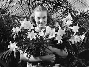 Young Woman with Arms Full of Easter Lillies by Philip Gendreau