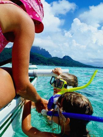 Children Snorkelling from Motor Boat, French Polynesia