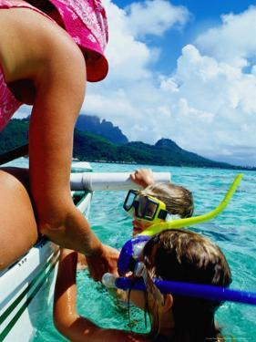 Children Snorkelling from Motor Boat, French Polynesia by Philip & Karen Smith