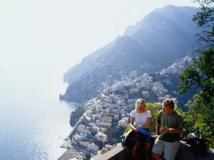 Couple Reading Guidebook on Lookout Above Town, Positano, Italy by Philip & Karen Smith