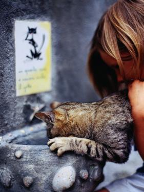 Girl Helping Cat at Cat Fountain, Positano, Campania, Italy by Philip & Karen Smith