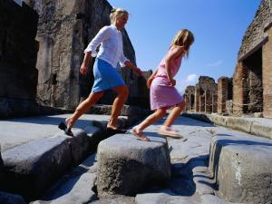Mother and Daughter Crossing Ancient Street, Pompeii, Italy by Philip & Karen Smith