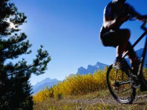 Mountain Biker in Autumn, Canmore, Canada by Philip & Karen Smith
