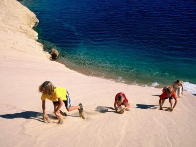 Overhead of Children Climbing Sand Dune