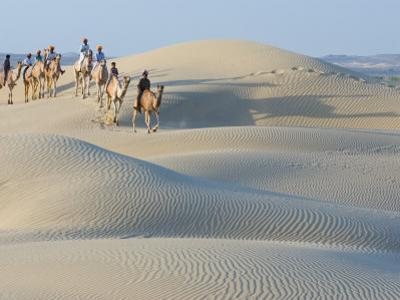 Men Traveling on Camelback Across Sand Dunes, Jaisalmer, Rajasthan, India