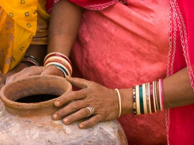 Woman's Hands on a Pottery Jug for Carrying Water, Thar Desert, Jaisalmer, Rajasthan, India