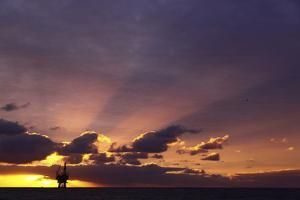 Sunrise At The Eider Platform, 60 Miles Northeast Of Shetland, North Sea by Philip Stephen
