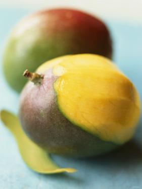 Two Mangos, One Partly Sliced by Philip Webb
