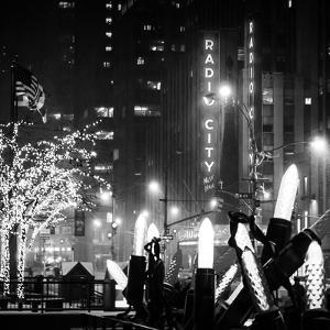 Christmas Decorations in front of the Radio City Music Hall in the Snow on a Winter Night by Philippe Hugonnard