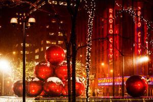 Christmas Decorations in front of the Radio City Music Hall in the Snow by Philippe Hugonnard