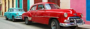 Cuba Fuerte Collection Panoramic - Two Classic Red and Turquoise Cars by Philippe Hugonnard