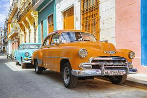 Cuba Fuerte Collection - Two Chevrolet Cars Orange and Turquoise by Philippe Hugonnard