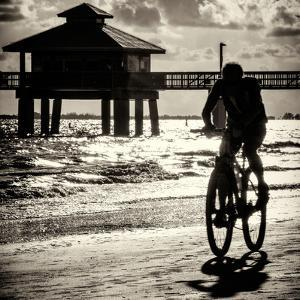 Cyclist on a Florida Beach at Sunset by Philippe Hugonnard