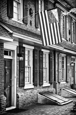 Front of House with an American Flag, Philadelphia, Pennsylvania, US, White Frame by Philippe Hugonnard