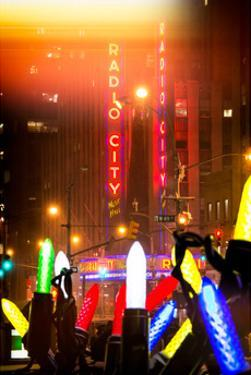 Instants of NY Series - Giant Christmas wreath in front of Radio City Music Hall on a Winter Night by Philippe Hugonnard