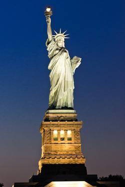 Liberty Island by Night - Statue of Liberty - Manhattan - New York City - United States by Philippe Hugonnard