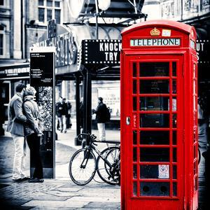 Loving Couple Kissing and Red Telephone Booth - London - UK - England - United Kingdom - Europe by Philippe Hugonnard