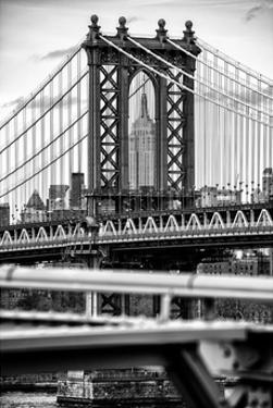 Manhattan Bridge with the Empire State Building Center from Brooklyn Bridge by Philippe Hugonnard
