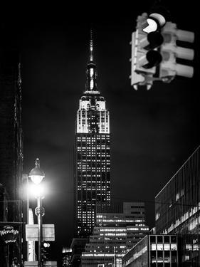 NYC Urban Street Scene - The Empire State Building at Night with a Red Light by Philippe Hugonnard