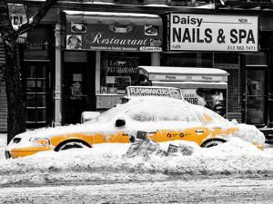 NYC Yellow Cab Buried in Snow by Philippe Hugonnard