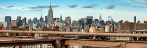 Panoramic Cityscape - View of Brooklyn Bridge with the Empire State Buildings by Philippe Hugonnard