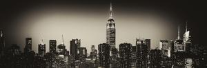 Panoramic Skyline of the Skyscrapers of Manhattan by Night from Brooklyn by Philippe Hugonnard