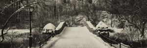 Panoramic View - Snowy Gapstow Bridge of Central Park, Manhattan in New York City by Philippe Hugonnard