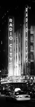 Radio City Music Hall and Yellow Cab by Night, Manhattan, Times Square, New York City by Philippe Hugonnard