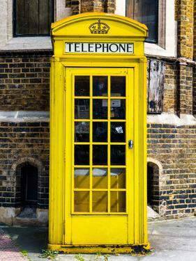 Red Phone Booth painted Yellow in London - City of London - UK - England - United Kingdom - Europe by Philippe Hugonnard