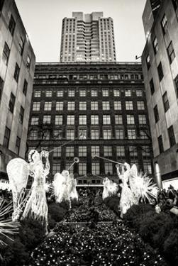 Rockefeller Center and 5th Ave Views with Christmas Decoration at Nightfall by Philippe Hugonnard