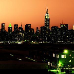 Skyline of the Skyscrapers of Manhattan by Orange Night from Brooklyn by Philippe Hugonnard