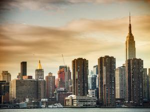 Skyline with Empire State Building at Sunset by Philippe Hugonnard