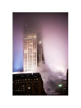 Skyscrapers in the Fog by Night at Downtown Manhattan by Philippe Hugonnard
